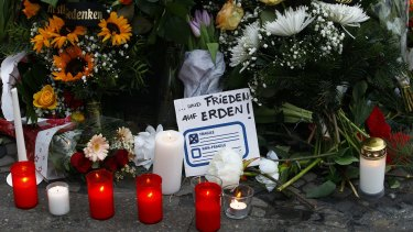 """A message reading """"Freedom on Earth"""" at a memorial for the victims of the Berlin terror attack."""