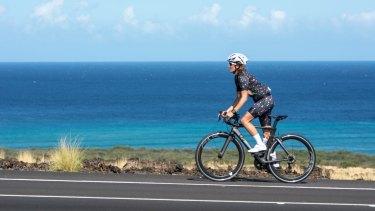 A woman wearing Fondo cycling gear rides a Kukio bike.