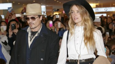 Amber Heard and Johnny Depp, pictured in 2015, will settle their divorce case.
