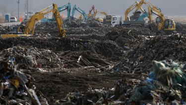 The rubble of Namie: Workers remove debris from the 2011 tsunami on February 24, 2015.