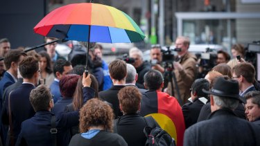 Same-sex marriage supporters address the media outside the High Court on 7 September 2017.