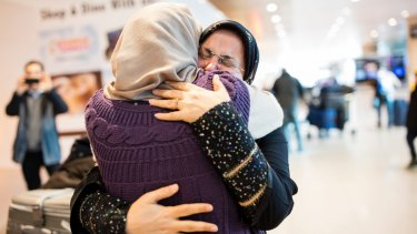 Sahar Harati, left, who moved from Iran to the US, embraces her mother as her parents arrive at Logan International Airport in Boston in early February.