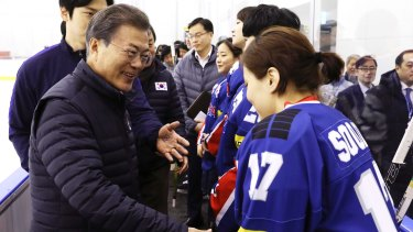 South Korean President Moon Jae-in greets members of South Korea's women's hockey team, some of whom oppose the proposal to form a joint team with North Korea.