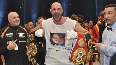 Ecstatic: Britain's new world champion Tyson Fury celebrates with the WBA, IBF, WBO and  IBO belts.