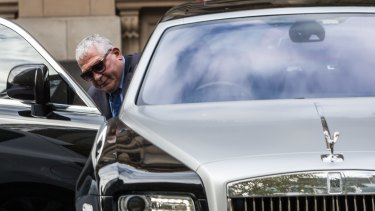 Mick Gatto leaves court in a Rolls Royce.