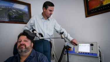 John Campbell receiving TMS treatment from Professor Paul Fitzgerald.