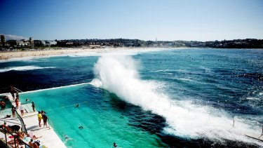 A wave swamps the pool at Bondi Icebergs.