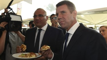 Former premier Mike Baird on the 2015 campaign trail in Auburn with the party's candidate Ronney Oueik, a former Auburn councillor.