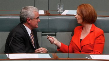 Tasmanian independent Andrew Wilkie and former Labor PM Julia Gillard fell out over an abandoned pokies deal.