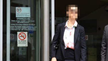 Senior Constable Kylie Anne Larfield leaves the Roma Street Magistrates Court.
