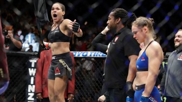 Amanda Nunes celebrates her win over  Ronda Rousey.