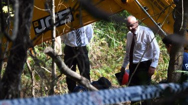 Detectives at the search site in the Royal National Park on Friday.