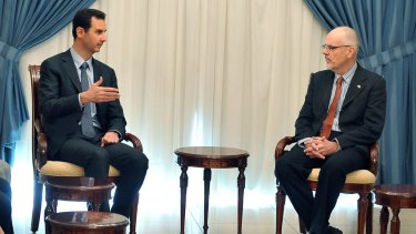 In this photo released by the Syrian official news agency SANA, Syrian President Bashar al-Assad meets with Australian professor Tim Anderson and a delegation including academics, researchers and activists in Damascus in 2013.