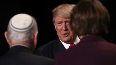 Donald Trump greets attendees during the National Prayer Breakfast in Washington on Thursday.