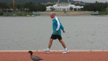 Former prime minister John Howard on one of his legendary morning walks.