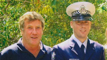 Michael Maynes and his father Robert on his graduation day.