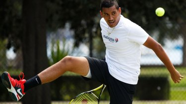 Nick Kyrgios hits some balls   during the announcement of his partnership with Malaysian Airlines.