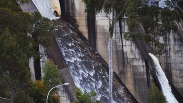 Water flows over the Warragamba Dam spillway on Thursday morning.