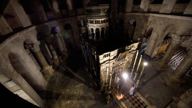 """Greek Orthodox priests hold liturgy outside """"the tomb of Jesus""""."""