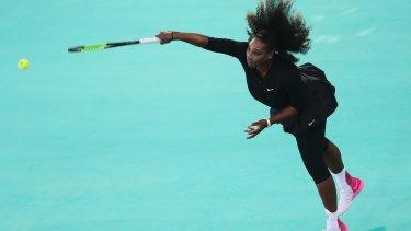 Serena Williams serves the ball to Jelena Ostapenko.