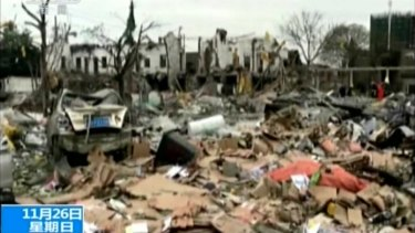 Debris from the explosion, as shown on China's CCTV.