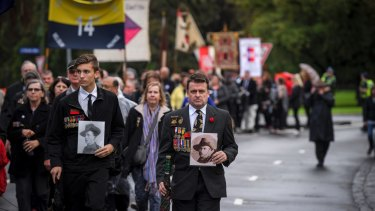 Son and father Paul (left) and Grant Holland (right) marched in the alternative Anzac Day parade near the Shrine of Remembrance.
