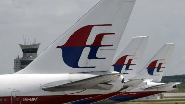 Malaysia Airlines planes parked on the tarmac at Kuala Lumpur International Airport.