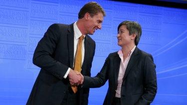 Senators Wong and Bernardi shake hands at the end of the debate.