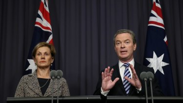 Education Minister Christopher Pyne, pictured with Universities Australia chief executive Belinda Robinson, announces the backdown on Monday.