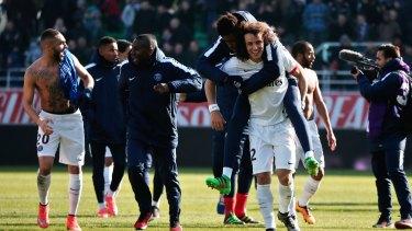 PSG players celebrate winning the title.