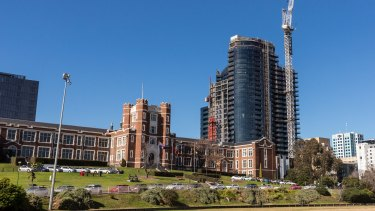 Melbourne High School (foreground) and the development at 661 Chapel Street, South Yarra, behind it.