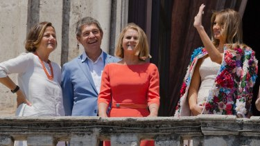 First spouses: Melania Trump (right) waves as she stands with, from left, the spouse of Italian Premier Paolo Gentiloni, Emanuela Mauro, spouse of German Chancellor Angela Merkel, Joachim Sauer, and spouse of European Council President Donald Tusk, Malgorzata Tusk.