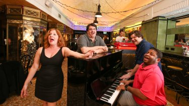 "Marie's Crisis hosts (from left), Jennifer Pace, Marc Castelli, Adam Tillford and Kenney Green, ""the world's only sing-a-long, show tune acoustic piano bar""."