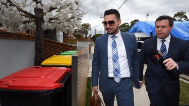 Salim Mehager questioned by a journalist outside his Lidcombe home on Tuesday.