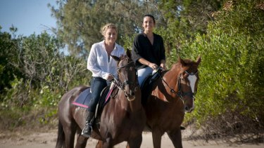 Liz and Harrison in the saddle.