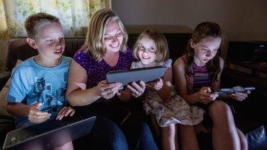 Recycling electronics: Larissa Shashkof, with children Harry, Elly and Lucy Boyd, has an e-waste box in their home.