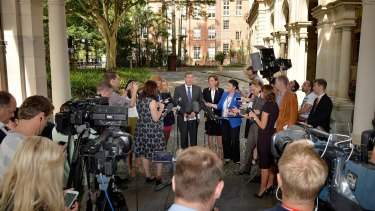The media gather around the new LNP leaders outside Parliament.
