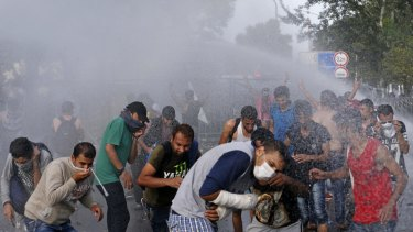Hungarian police spray water on migrants at the 'Horgos 2' border crossing near Horgos, Serbia.