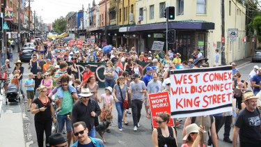 Concerned residents take to the streets of Newtown, Sydney, to protest the proposed development of the NSW government's WestConnex tunnel and road project.