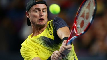 Testing times: Australia's Lleyton Hewitt pushed Roger Federer in their Fast4 match.