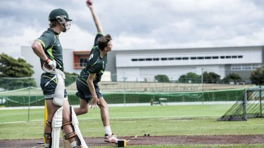Thursday 21 May 2015. QUT's innovation arm, bluebox, partnered with Cricket Australia to create a training aid that uses a sensor to detect when a bowler commits a no ball by overstepping the popping crease. Pictured at the National Cricket Centre are (left) Sam James, Bluebox Consultant and Troy Cooley (right), head coach at Cricket Australia and a former first-class cricketer. Photo:QUT Marketing and Communication/Erika Fish. PH:0731385003. The door-chime-based device in action at the  Cricket Australia National Performance Program at Allan Border Fields