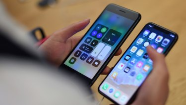 Apple has been pushing to overcome short supply of the new iPhone X (right).