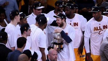 Matthew Dellavedova holds the trophy after the Cavaliers defeated the Hawks to make it to the NBA finals.