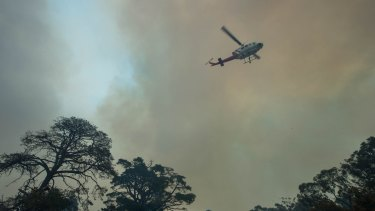 A helicopter protecting a home off Burke and Wills Track at Benloch