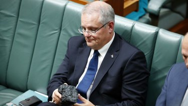 Treasurer Scott Morrison with a lump of coal during question time at Parliament House last year.
