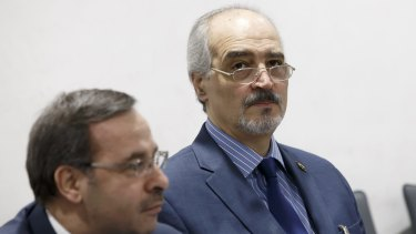 Bashar al-Jaafari, Syrian chief negotiator, right, at the peace talks in Geneva on Monday.