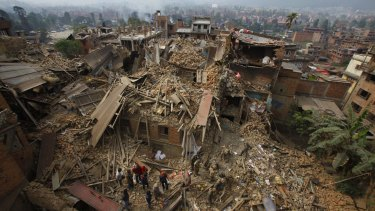 Rescue workers remove debris as they search for victims of earthquake in Bhaktapur near Kathmandu, Nepal.