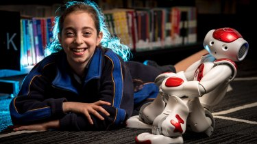 Grade 4 student Romy Szmulewicz with robot Rosie at the Bialik College.
