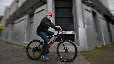 Baron Katrinski on an electric bike. Katrinski and business partner Nathan Reizer own Melbourne Electric Bicycles.