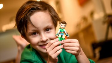 Charles Winnett playing with Tree Fu Tom, a modern action hero.